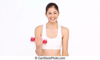 Woman doing exercise against white background