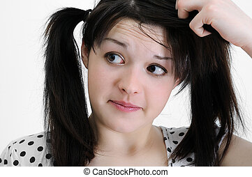 confused young brunette woman, touching her hair