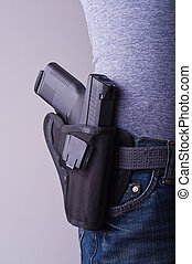 Holstered gun - Petit woman carrying holstered gun