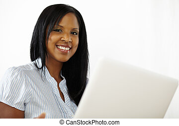 Cute young woman using a laptop - Portrait of a cute young...