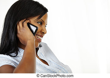 Cute young woman on cellphone