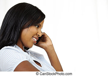 Smiling young woman on cellphone