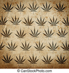 Grungy paper background with cannabis leaves - Grungy old...