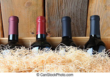 Closeup Wine Bottles in Crate - Closeup of four different...