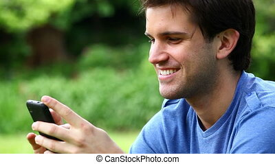 Smiling man using a mobile phone