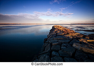 Stone Jetty on the Ottawa River - A stone jetty reaches...