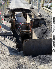 Sewerage digging, open street construction site - Digging...