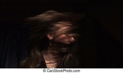 Beautiful girl shakes her hair
