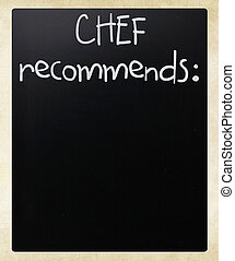 """Chef recommends"" handwritten with white chalk on a blackboard"