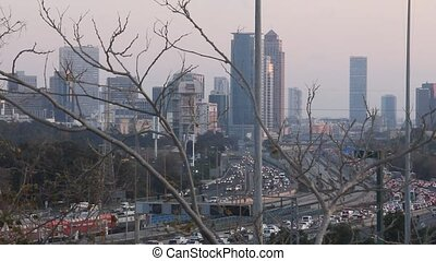 Tel Aviv at dusk .  Ayalon Highway. Ttraffic jam