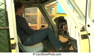 A pilot in the cockpit of the helicopter