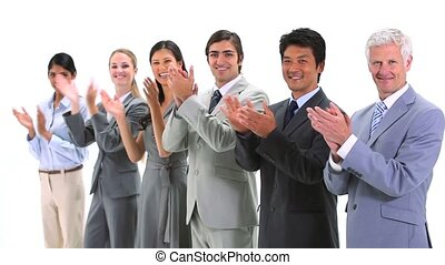 Multicultural team applauding against a white backgorund
