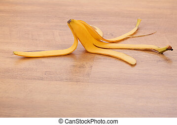 Banana skin - yellow banana skin on wooden table background
