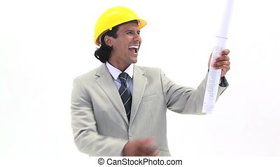 Happy man holding blueprints against a white background