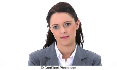 Thoughtful woman standing upright against a white background