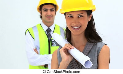 Business people wearing safety helmet against white...