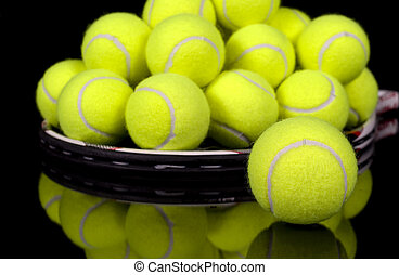 Tennis balls collected on tennis racket