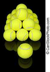 Tennis balls isolated on black