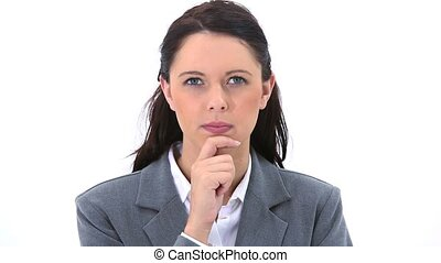 Serious secretary placing her hand on her chin against a...