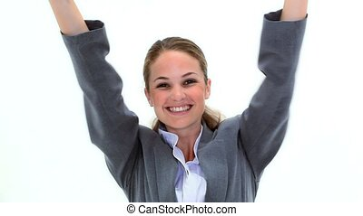 Blonde businesswoman raising her arms