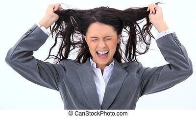 Woman pulling her hair against a white background