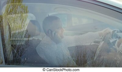 Businessman calling with cell phone - Mid adult caucasian...