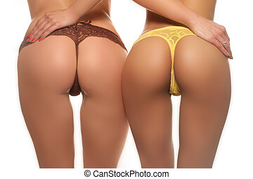 Two sexy butts - Two sexy female butts in brown and yellow...