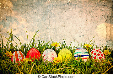 Grunge paper with Easter Eggs and flower on Fresh Green...