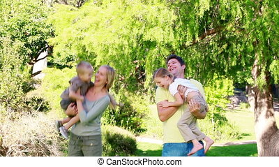 Parents playing with their children in a park