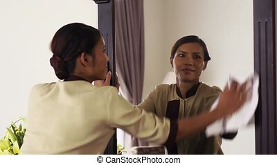 Happy housemaid working in hotel - Portrait of happy Asian...