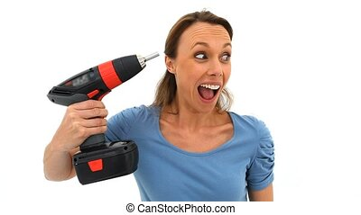 Brunette woman holding a drill against a white background