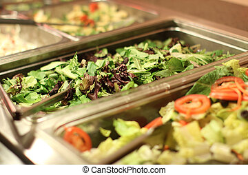 Salad bar - Freshly tossed mixed salad ready to eat.