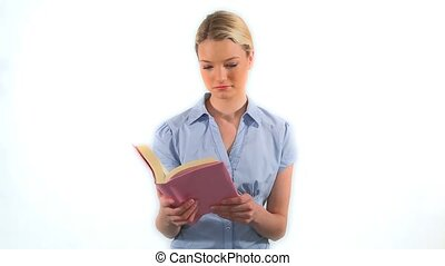 Serious blonde reading a book against a white background