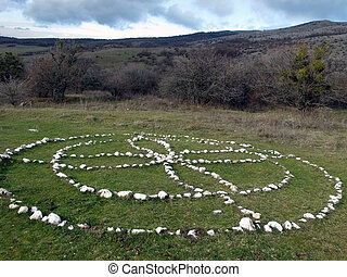 mystica circle on grass in mountains