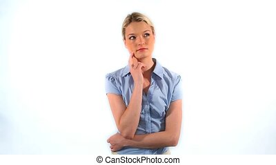 Blonde woman placing her hand on her chin against a white...