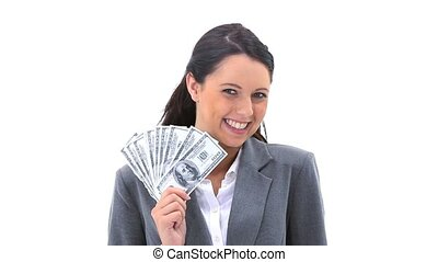 Businesswoman holding American banknotes is smiling