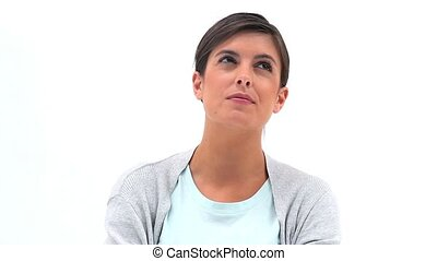 Thoughtful woman looking up against white background
