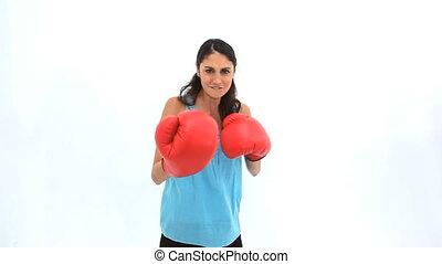 Brunette wearing box gloves against white background
