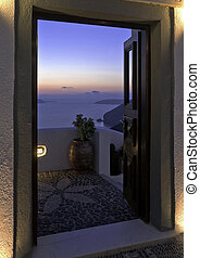 Santorini Caldera twilight view trough the open door -...