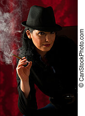 Beauty woman smoking in the night