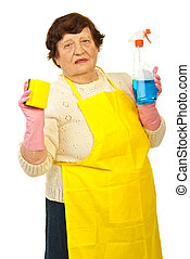 Elderly showing cleaning products - Elderly woman showing...