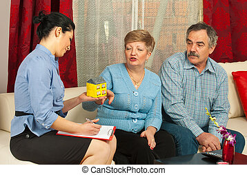Real estate agent with mature couple - Real estate agent...