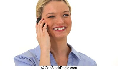 Blonde woman using her mobile phone