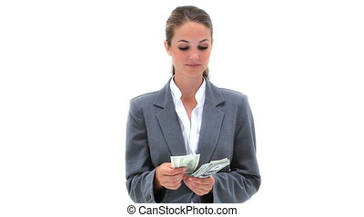 Businesswoman counting dollars banknote against white...