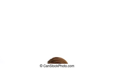 Redhead woman on the phone against white background