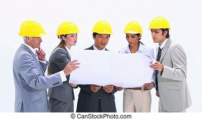 Business team wearing safety helmet against a white...