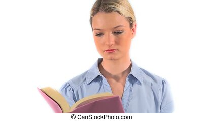 Blonde young woman reading a book