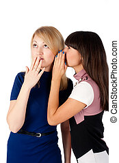 Two gossiping friends - Attractiv? young women. One gossip...