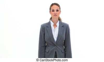 Blonde businesswoman with her hands on hips against white...