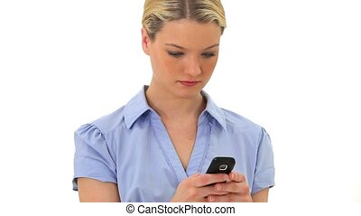 Serious blonde woman sending a text